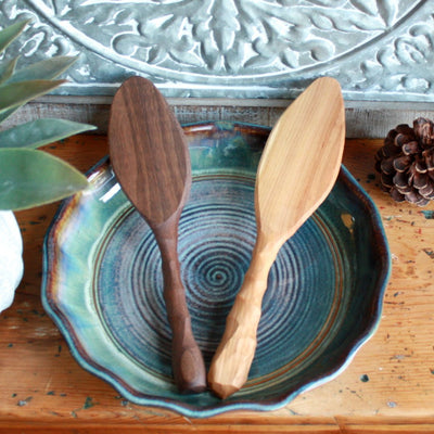 Arrangement of charming rustic handmade wooden cake and pie servers made from cherry and black walnut urban wood