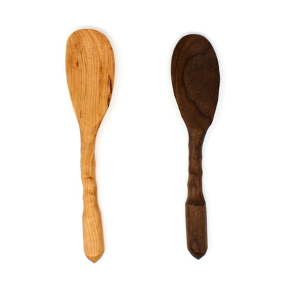 A pair of charming, rustic, handmade wood spoons made from sustainably harvested urban wood.