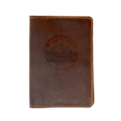 Cover of a leather journal embossed with the image of mountains and trees; handcrafted in AZ | LocalWe