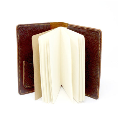 Inside standing up view of a leather journal embossed with the image of mountains and trees; handcrafted in AZ | LocalWe