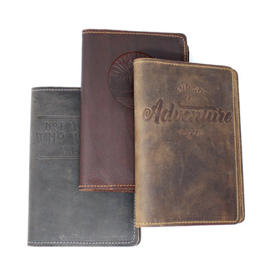 Three handcrafted leather journals with embossed covers; made in AZ | LocalWe