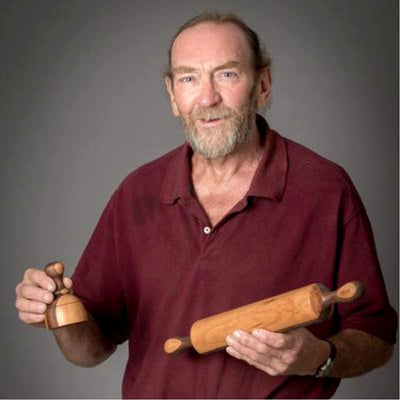 Artisan craftsman Leon Hoffman holding a cookie cutter and traditional rolling pin | LocalWe