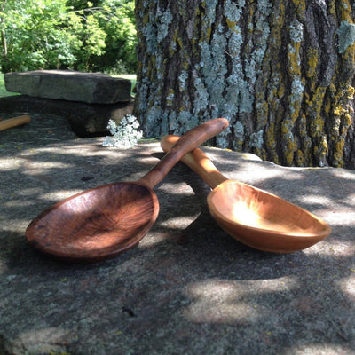 Picture of two handmade medium wood serving/stirring spoons made from light and dark wood; Shop Local Arkansas | LocalWe.com