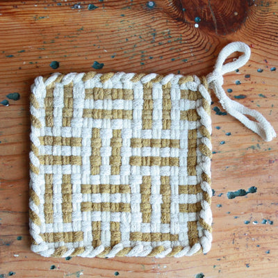 A lovely cotton handwoven potholders in ochre color.