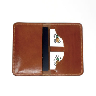 Open handcrafted leather passport cover showing cards and passport being held in case | Made in AZ | LocalWe