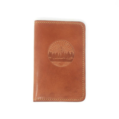 Handcrafted leather passport cover embossed with an image of Mountains and Trees, Made in AZ | LocalWe