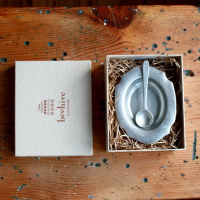 Open box view of pewter salt cellar and spoon hand cast by artisans. Shop Local Rhode Island.