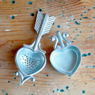 Open view of pewter tea strainer hand cast by artisans in Providence, RI. Shop Local Rhode Island.