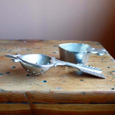 Side open view of pewter tea strainer hand cast by artisans. Shop Local Rhode Island.