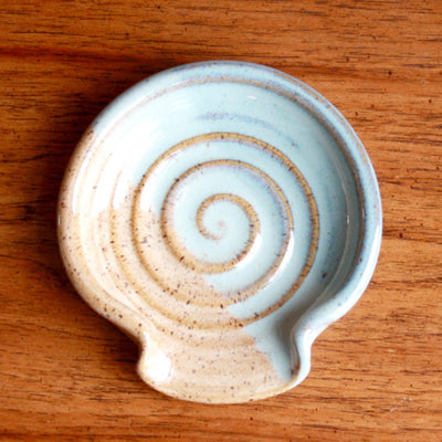 A hand thrown pottery spoon rest in Big Sky and Caramel color