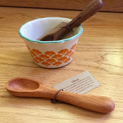 Photo of two handmade wood sugar/baby spoons, one lying on table with gift tag and one resting in sugar bowl | LocalWe