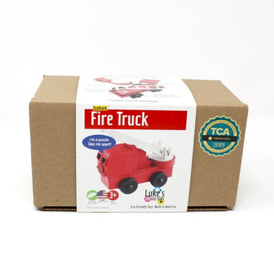 Package view of red toy fire truck made out of saw dust and recycled plastic that is a STEM toy that develops problem solving