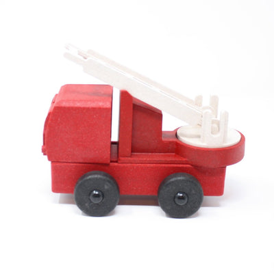 Side view of red toy fire truck made out of saw dust and recycled plastic that is a STEM toy that develops problem solving