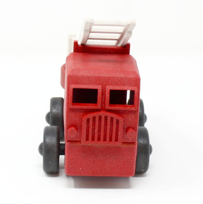 Front view of red toy fire truck made out of saw dust and recycled plastic is a STEM toy that develops problem solving