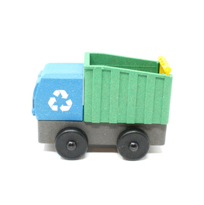 Side view of blue toy recycling truck truck made out of saw dust and recycled plastic that is a STEM toy that develops problem solving