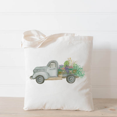 Picture of a canvas tote bag with a watercolor painting of an antique truck carrying a truck bed full of flowering plants | Made in New Jersey | LocalWe