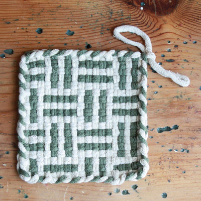 A lovely cotton handwoven potholders in willow color.