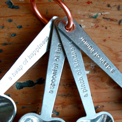View of quotes on zinc measuring spoons with quotes. Hand cast by artisans. Shop Local Rhode Island.