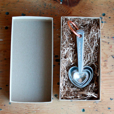 Open box view of zinc measuring spoons with quotes. Hand cast by artisans. Shop Local Rhode Island.