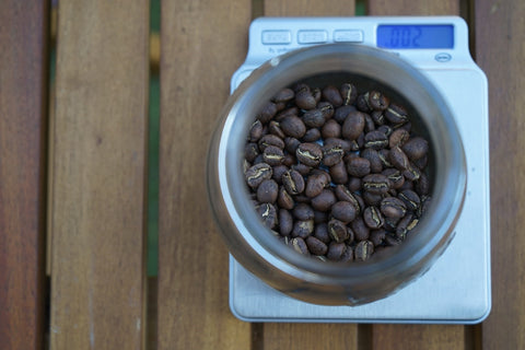 Measuring coffee beans on scale
