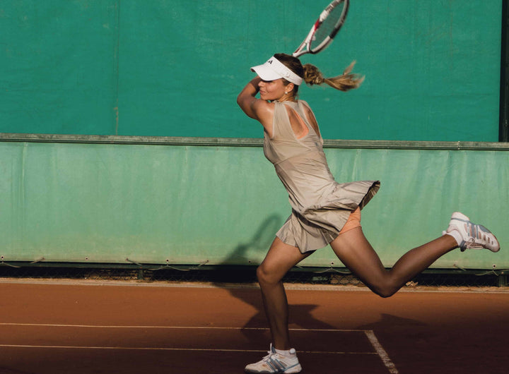 Woman following through on tennis backhand