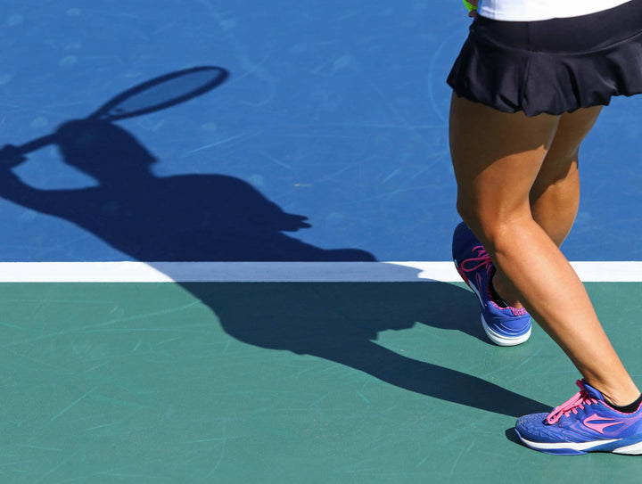 Closeup of tennis players legs while serving
