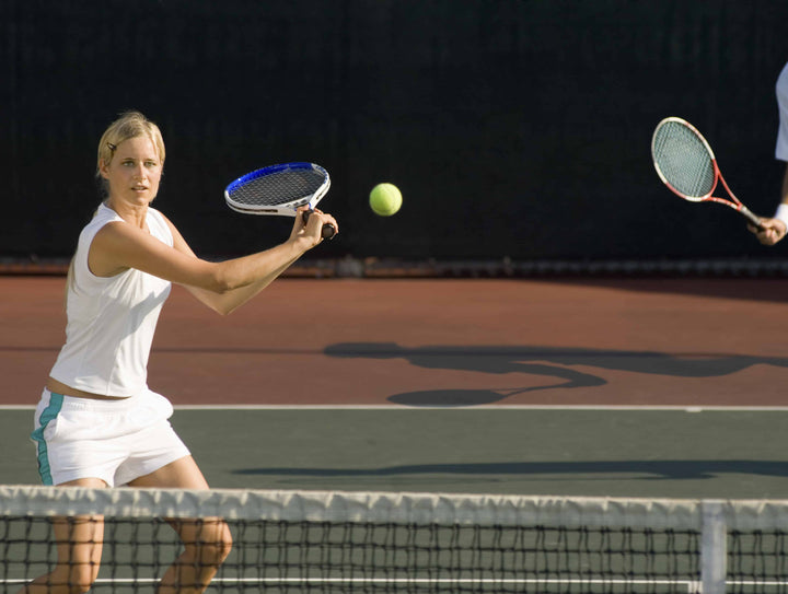 Woman tennis player hitting a slice shot
