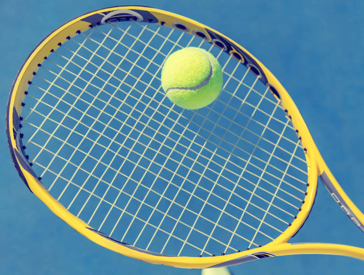 Tennis ball on tennis racquet