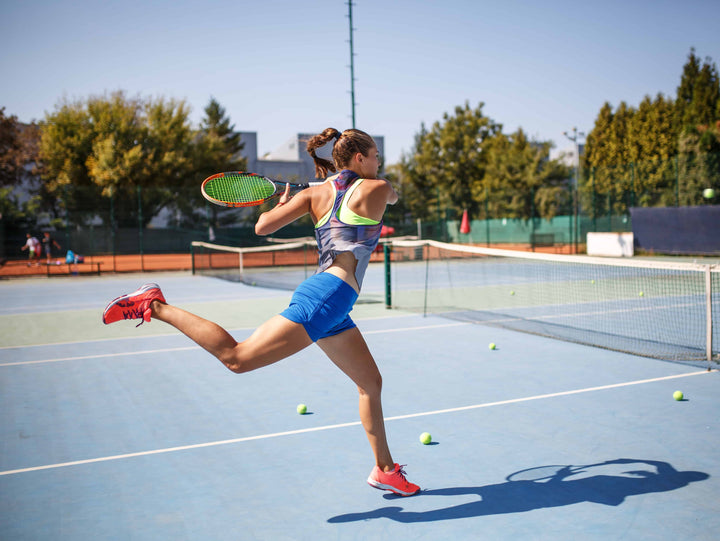 Woman tennis player practicing her forehand