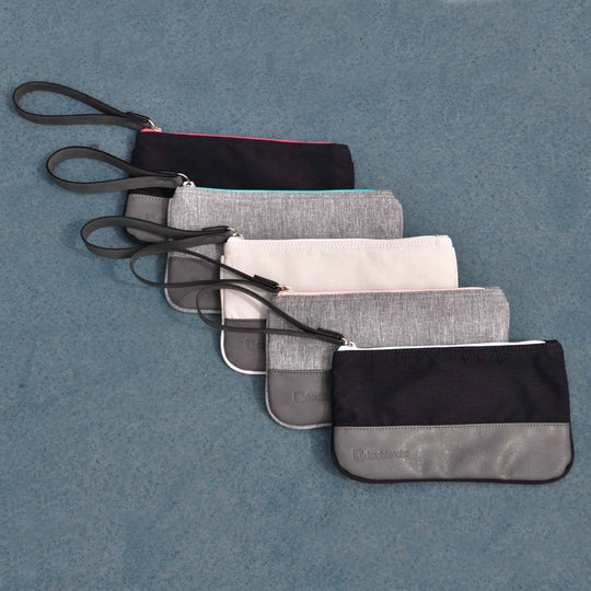 Doubletake accessory bags lined up on tennis court