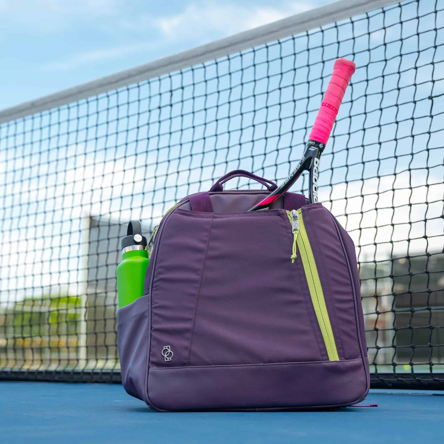 Doubletake tennis bag on the court