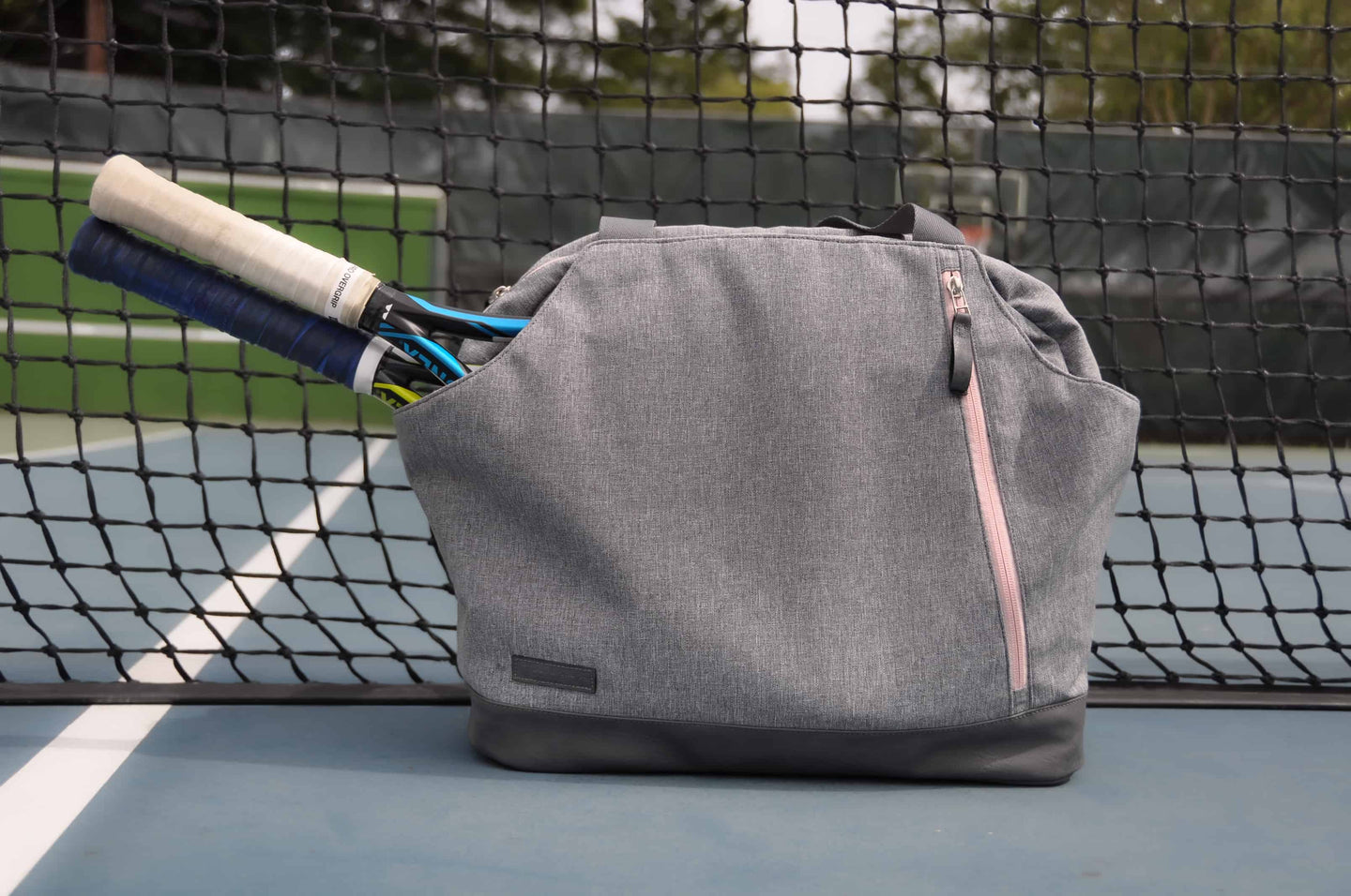 Doubletake tennis duffel in heathered grey and blush pink