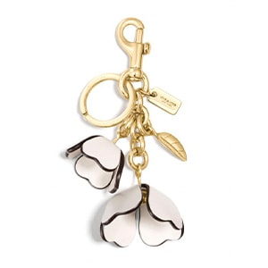 Coach pink and white floral keychain.