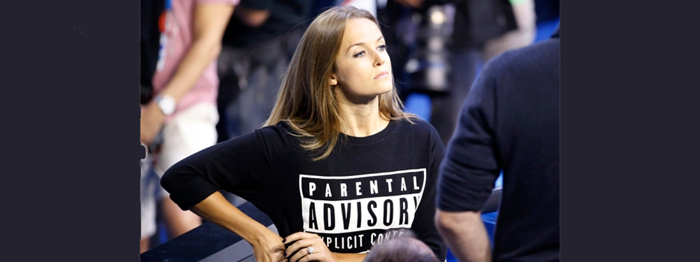 Woman wearing shirt that says parental advisory explicit content