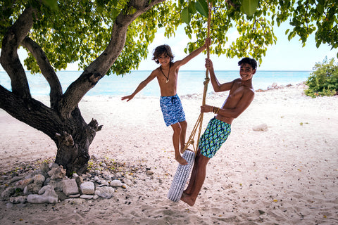 boys at the beach wearing sunuva swim shorts