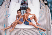 kids on the boat wearing sunuva swimwear