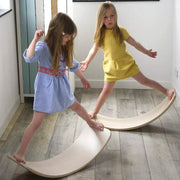 girls on wobbel balancing board