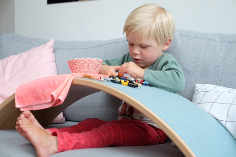 boy playing on wobbel balancing board