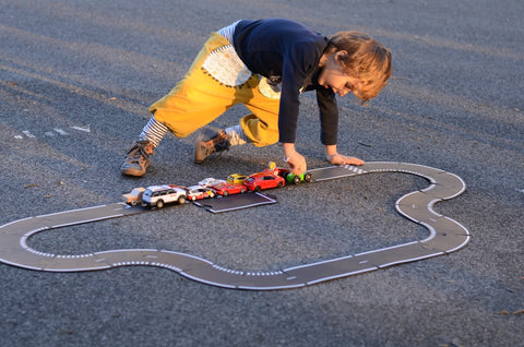 child playing with waytoplay grand prix flexible 24 race track