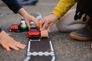children playing with waytoplay grand prix flexible 24 race track