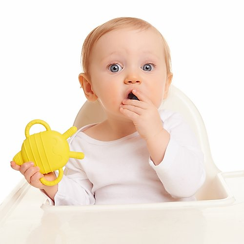 toddler holding a hashtag kidz yellow bee chewbuddy teether and snack container