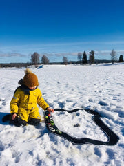 child playing in snow with waytoplay grand prix flexible 24 race track