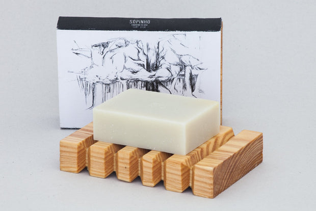 bar of soap on wooden soap dish