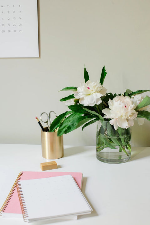 appointed pink notebook on the table