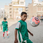 child in nepal with Park SSC orange football