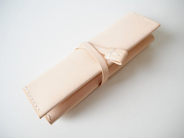 Abokika leather Jewellery Roll Nude rolled up