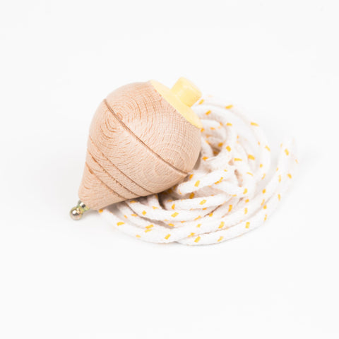 sustainable beech wood spinning top with string toy