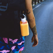nuoc water bottle attached to a backpack