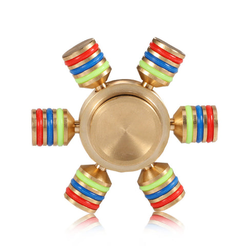 New Pretty Copper Colored Finger Spinner.  The red, blue and green strips turn into red, blue and green CIRCLES around your finger when it spins fast.  How cool is that?