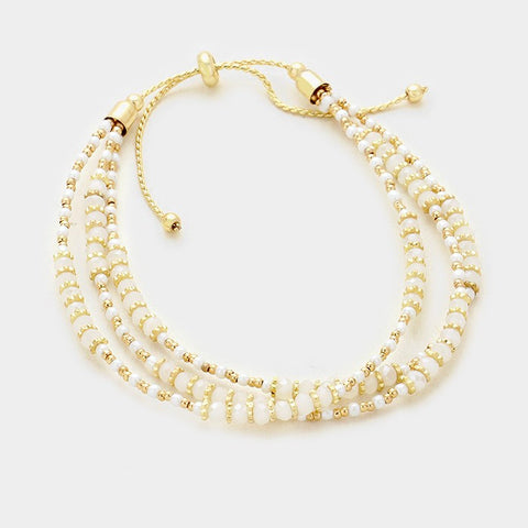 White and Gold Multi Layered Bead Bracelet